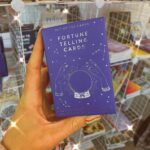 A purple pack of fortune telling cards from Crystal Eclipse at Beach Street Felixstowe