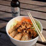 The Viet Street Food Company takeaway food with Asahi beer.